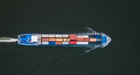 Container ship cutting across the sea